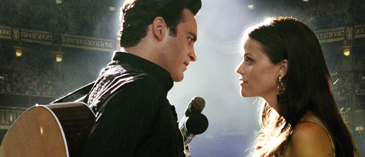 WTL-676 Johnny Cash (Joaquin Phoenix) and June Carter (Reese Witherspoon) perform in WALK THE LINE. Photo credit: Suzanne Tenner TM and © 2005 Twentieth Century Fox. All Rights Reserved. Not for sale or duplication.